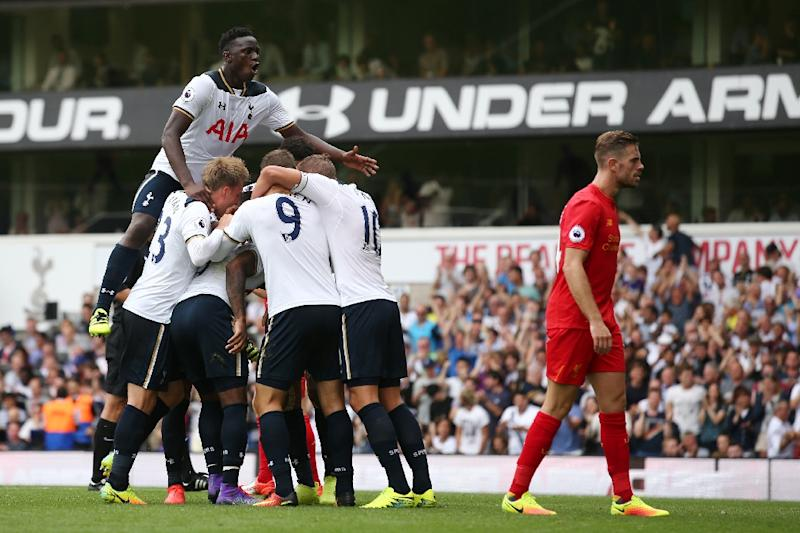 Tottenham's Victor Wanyama (top) celebrates with teammates after defender Danny Rose equalised during the Premier League match against Liverpool at White Hart Lane in London, on August 27, 2016