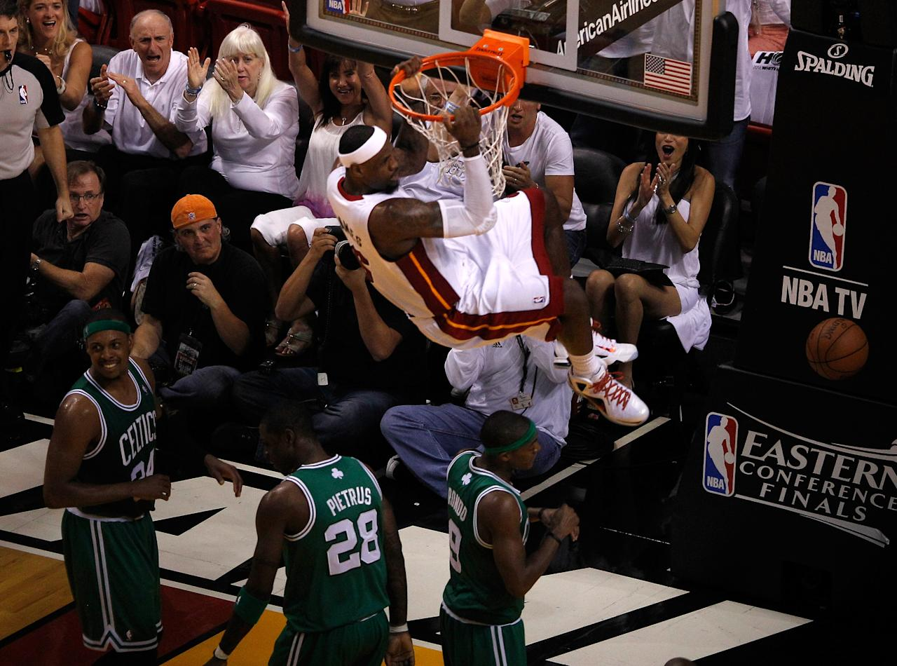 MIAMI, FL - JUNE 09:  LeBron James #6 of the Miami Heat dunks the ball in the second quarter while taking on the Boston Celtics in Game Seven of the Eastern Conference Finals in the 2012 NBA Playoffs on June 9, 2012 at American Airlines Arena in Miami, Florida. NOTE TO USER: User expressly acknowledges and agrees that, by downloading and or using this photograph, User is consenting to the terms and conditions of the Getty Images License Agreement.  (Photo by J. Meric/Getty Images)
