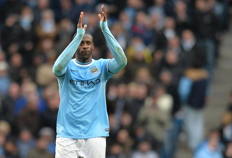 Manchester City midfielder Yaya Toure celebrates after scoring his team's third goal and completing his hat-trick during an English Premier League match at the Etihad Stadium in Manchester, north-west England, on March 22, 2014