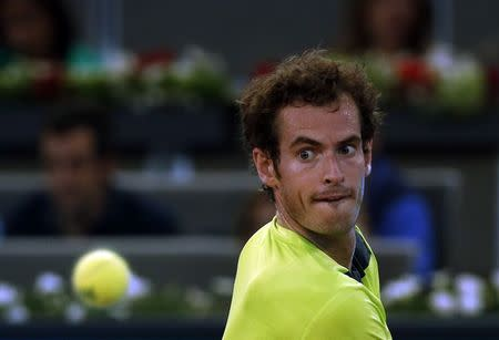 Murray of Britain eyes the ball before returning it to Almagro of Spain during their match at the Madrid Open tennis tournament