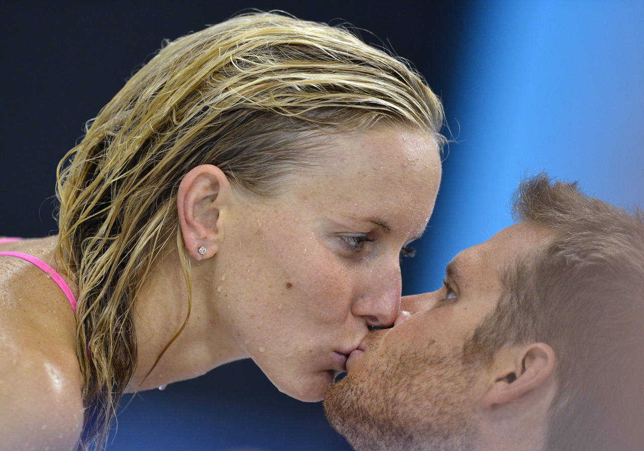 Jessica Hardy of the U.S. kisses her boyfriend Dominik Meichtry of Switzerland during a training session at the Aquatics Centre before the start of the London 2012 Olympic Games July 27, 2012.   REUTERS/Toby Melville (BRITAIN  - Tags: OLYMPICS SPORT SWIMMING)