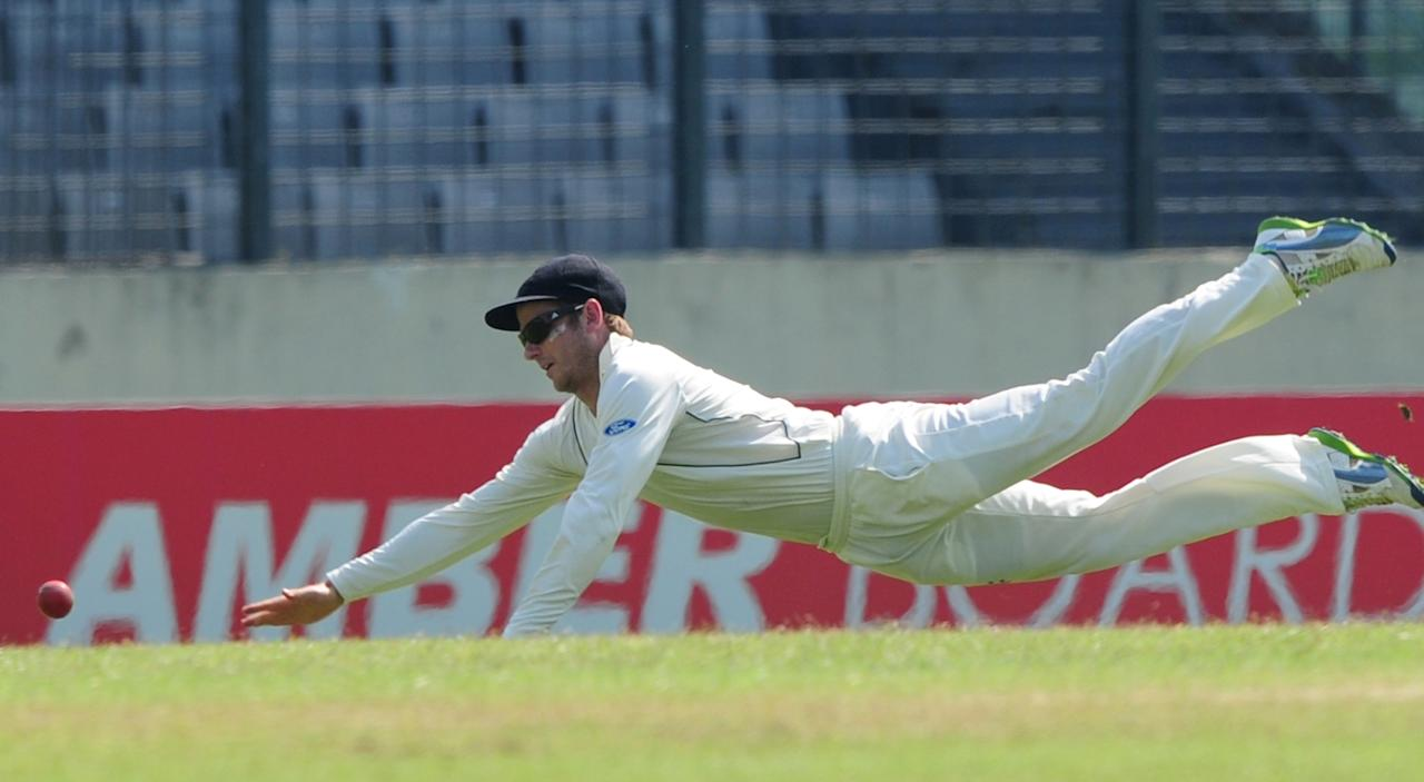 New Zealand cricketer Kane Williamson tries to catch a ball during the fourth day of the second cricket Test match between Bangladesh and New Zealand at the Sher-e Bangla National Stadium in Dhaka on October 24, 2013. AFP PHOTO/ Munir uz ZAMAN        (Photo credit should read MUNIR UZ ZAMAN/AFP/Getty Images)