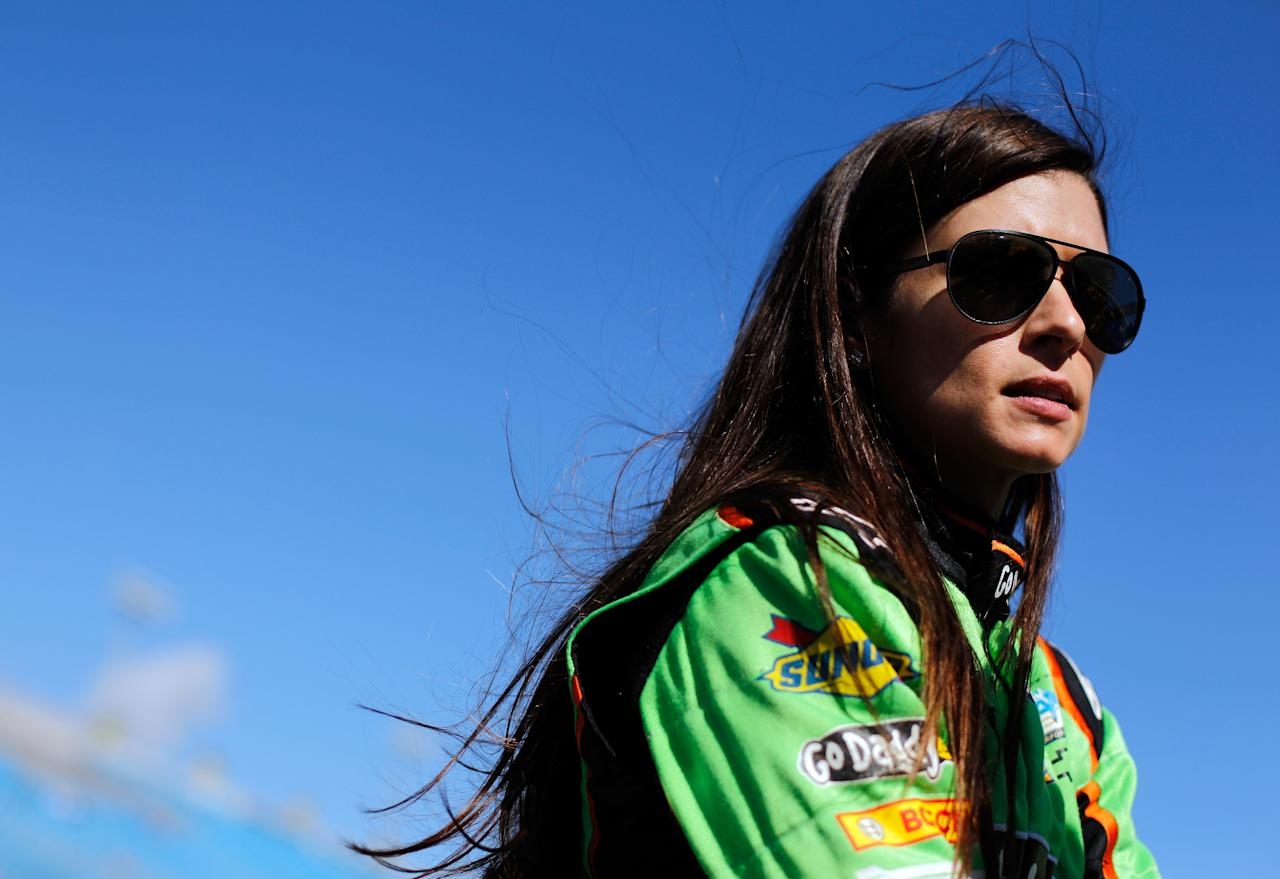 HOMESTEAD, FL - NOVEMBER 17:  Danica Patrick, driver of the #7 GoDaddy.com Chevrolet, stands on the grid during qualifying for the NASCAR Nationwide Series Ford EcoBoost 300 at Homestead-Miami Speedway on November 17, 2012 in Homestead, Florida.  (Photo by Tom Pennington/Getty Images)