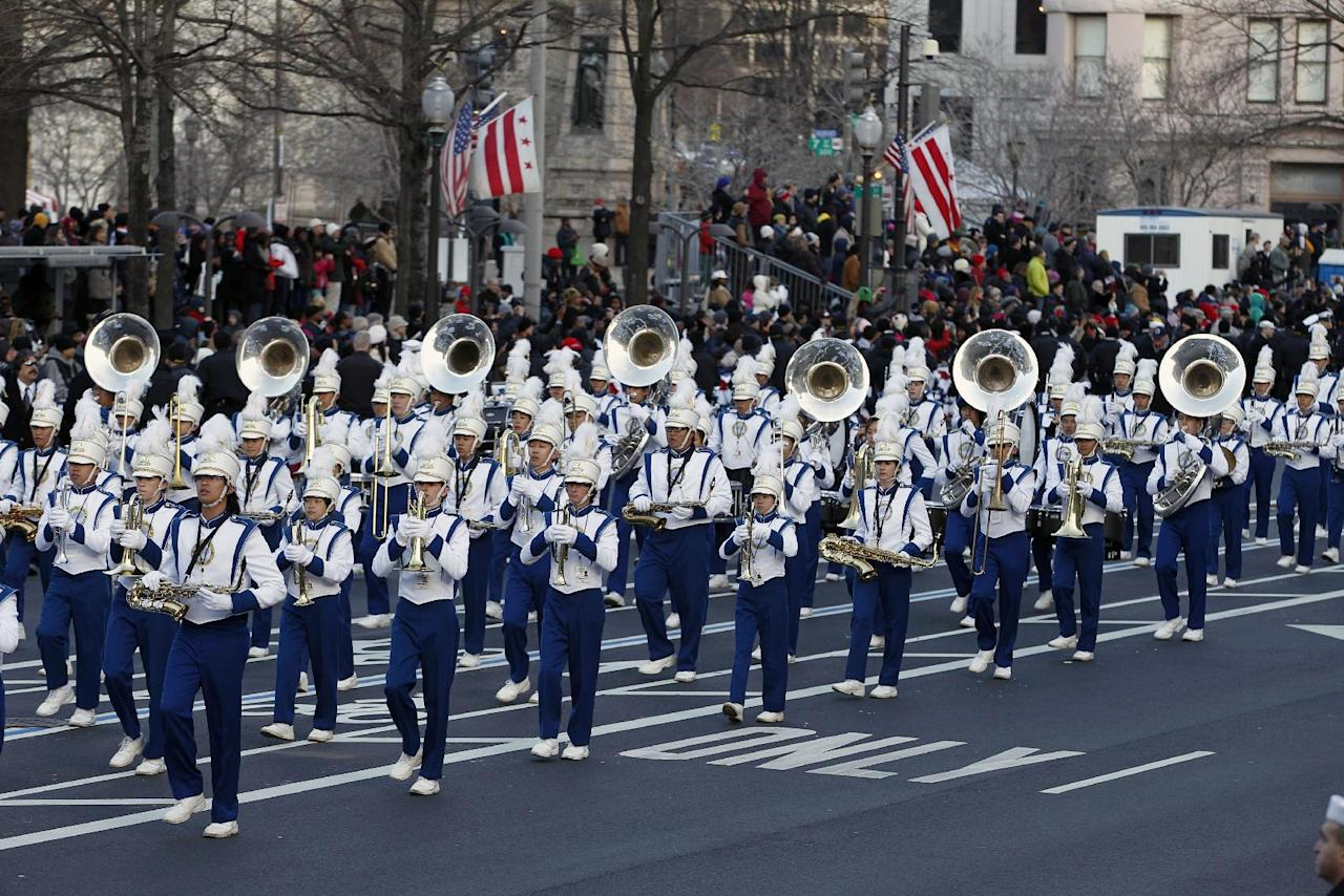 The Punahou Band and JROTC, Punahou School, Honolulu, Hawaii, performs in President Barack Obama's inaugural parade in Washington, Monday, Jan. 21, 2013, following the president's ceremonial swearing-in ceremony during the 57th Presidential Inauguration. ( AP Photo/Jose Luis Magana)