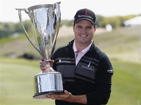 Johnson of U.S. poses with trophy after winning BMW Championship golf tournament at Conway Farms Golf Club in Lake Forest