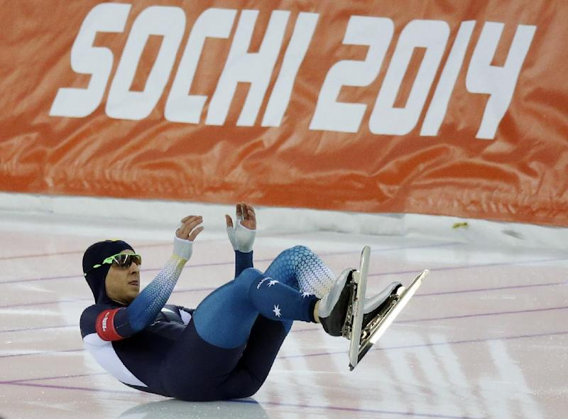 Australia's Daniel Greig crashes in the first heat of the men's 500-meter speedskating race at the Adler Arena Skating Center during the 2014 Winter Olympics, Monday, Feb. 10, 2014, in Sochi, Russia