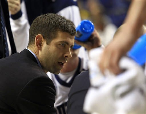 Butler  head coach Brad Stevens talks to his players during the first half  a second round NCAA college basketball tournament game against Bucknell Thursday, March 21, 2013, in Lexington, Ky.  (AP Photo/James Crisp)