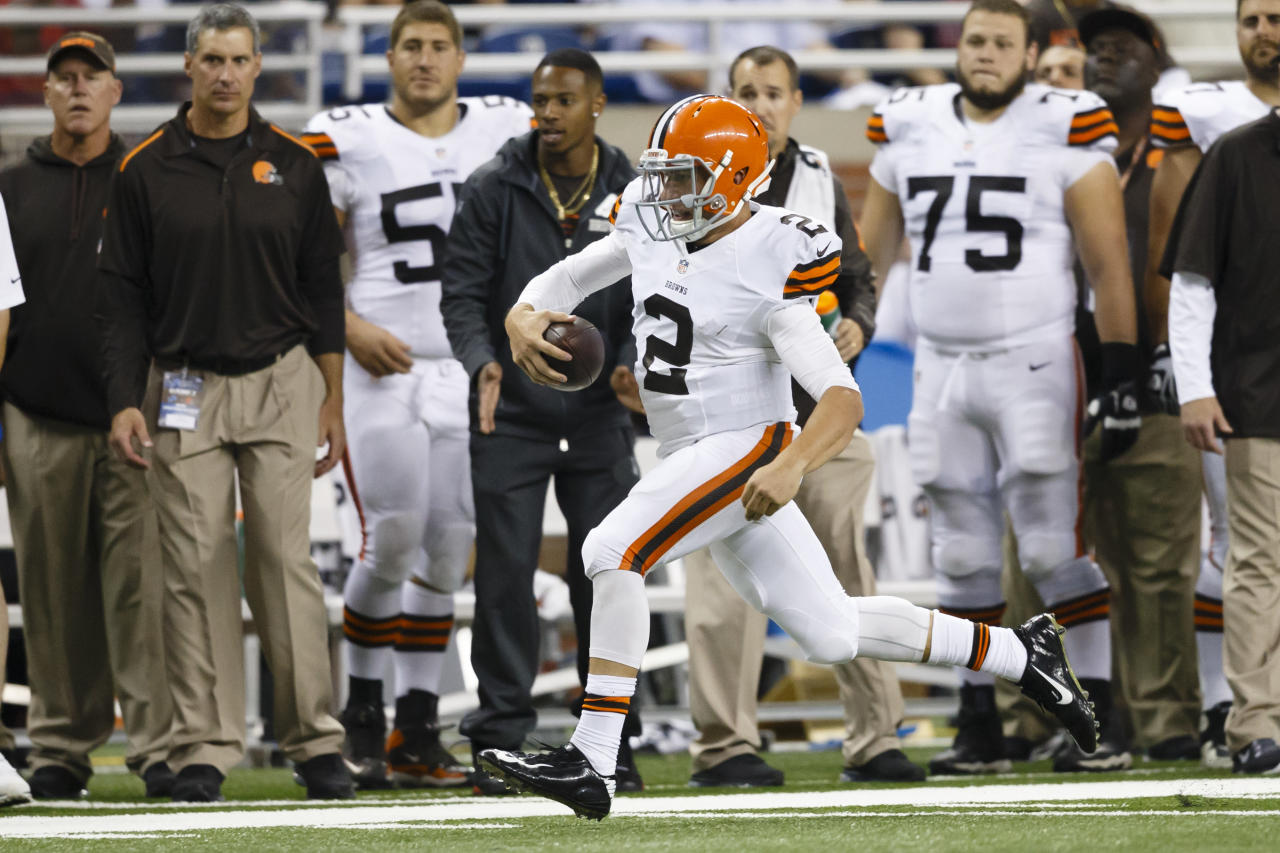 Cleveland Browns quarterback Johnny Manziel (2) runs the ball against the Detroit Lions during a preseason NFL football game at Ford Field in Detroit, Saturday, Aug. 9, 2014. (AP Photo/Rick Osentoski)