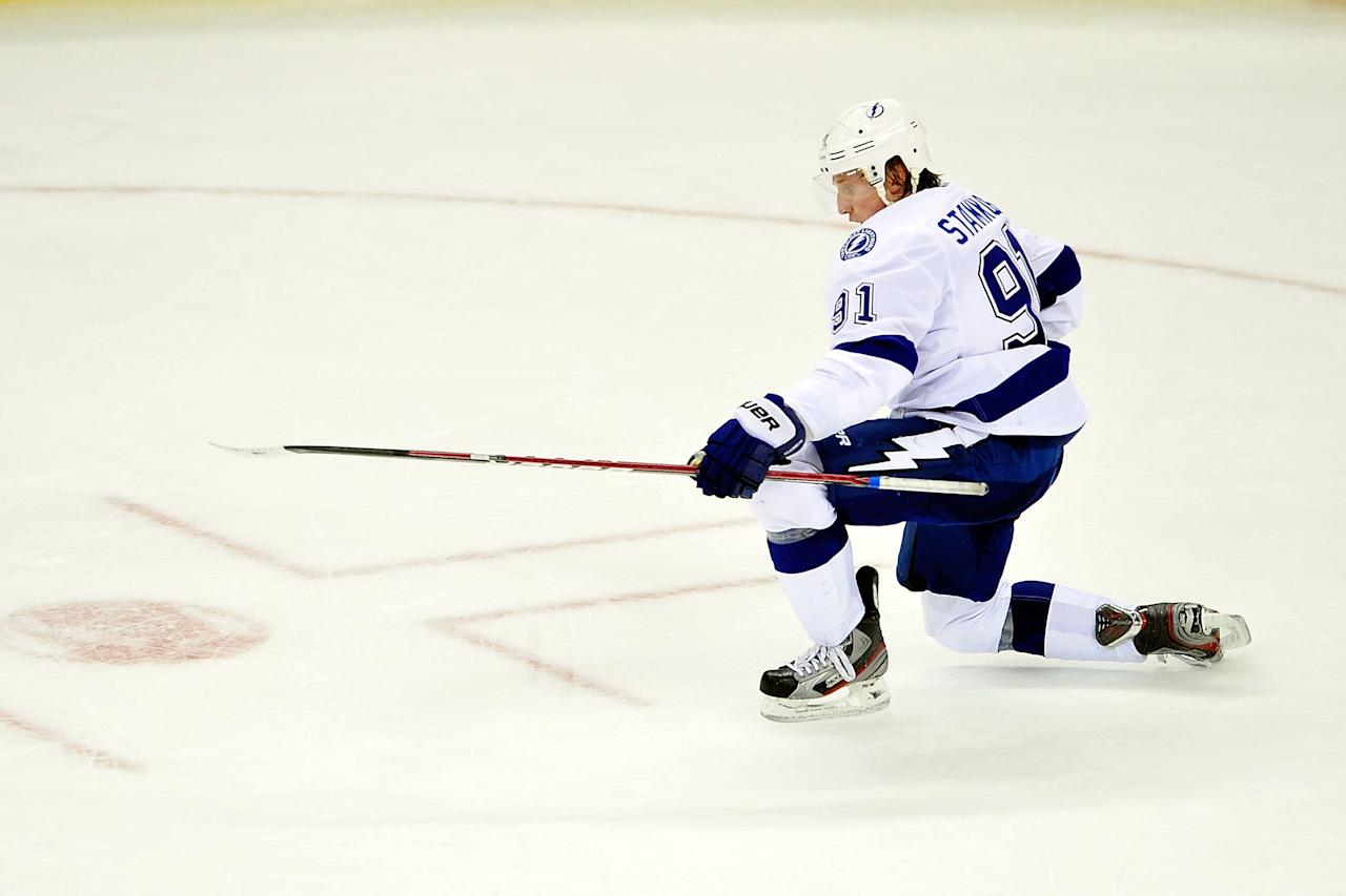 RALEIGH, NC - MARCH 03:  Steven Stamkos #91 of the Tampa Bay Lightning celebrates after scoring the game-winning goal against the Carolina Hurricanes during overtime at the RBC Center on March 3, 2012 in Raleigh, North Carolina. The Lightning won 4-3 in overtime.  (Photo by Grant Halverson/Getty Images)