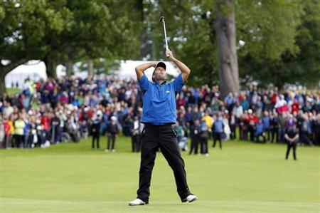 Italy's Molinari reacts to his first putt on the eighteenth green before winning the Scottish Open golf tournament at Loch Lomond golf course near Glasgow