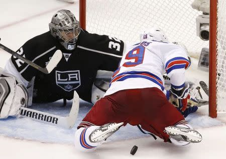 usspoLos Angeles Kings' goalie Jonathan Quick makes a save against the New York Rangers' Brad Richards during the third period in Game 2 of their NHL Stanley Cup Finals hockey series in Los Angeles