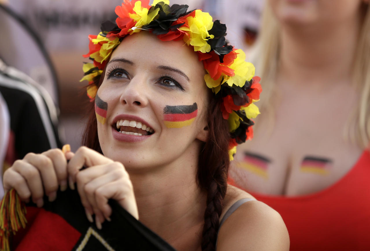 German soccer fans watch the Brazil World Cup quarter final soccer match between Germany and France, at a public viewing event in Berlin, Germany, Friday, July 4, 2014. Germany defeated France by 1-0. (AP Photo/Michael Sohn)