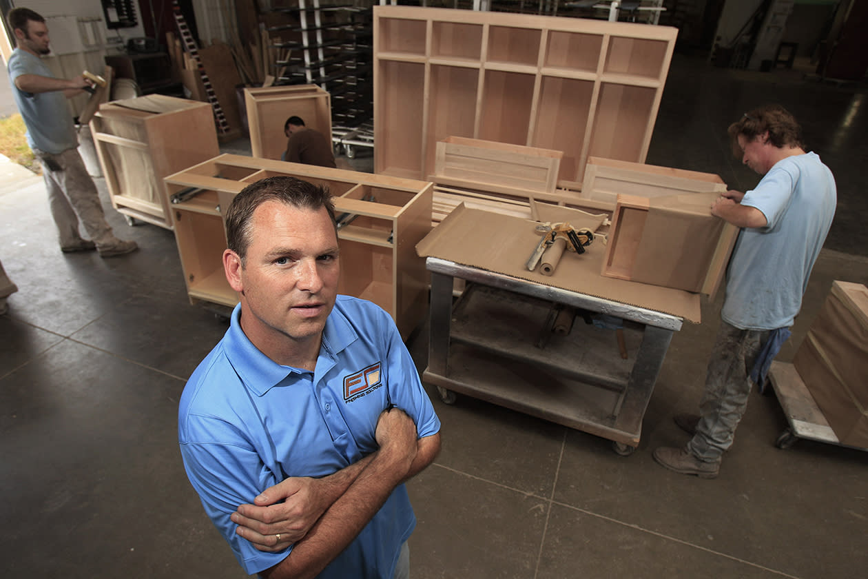 """Aaron Foust, who owns a wood refinishing company, poses for a photo in his workshop in Streetsboro, Ohio. Foust, a former Gov. Mitt Romney supporter, says President Barack Obama's words about welfare recipients don't match his deeds. Publicly, Foust says, the president is urging """"them to go to work, but if they (did) ... they wouldn't need him anymore. He needs their vote. As long as they're dependent on the government, they're going to vote for the people that give them money."""""""