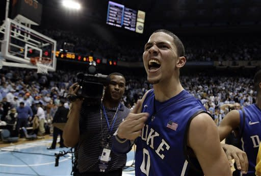 Duke's Austin Rivers (0) reacts after his game-winning basket against North Carolina following an NCAA college basketball game in Chapel Hill, N.C., Wednesday, Feb. 8, 2012. Duke won 85-84. (AP Photo/Gerry Broome)