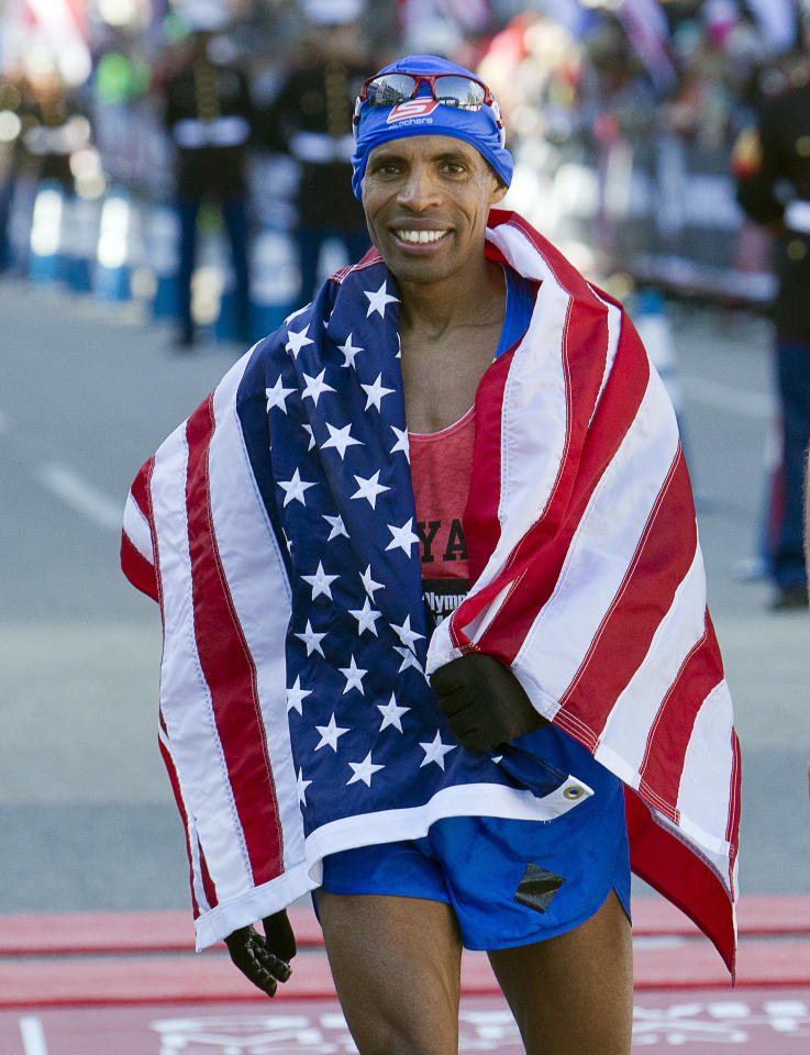 HOUSTON - JANUARY 14:  Meb Keflezighi drapes the American flag over his shoulders after taking  first place in the U.S. Marathon Olympic Trials with a time of 2:09:08 on January 14, 2012 in Houston, Texas.  (Photo by Bob Levey/Getty Images)