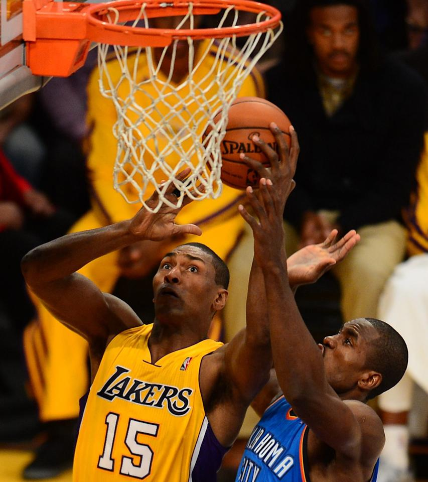 Serge Ibaka (R) of the Oklahoma City Thunder defends against  Metta World Peace  (L) of the Los Angeles Lakers on January 11, 2013 at Staples Center in Los Angeles, California. AFP PHOTO / Frederic J. BROWNFREDERIC J. BROWN/AFP/Getty Images