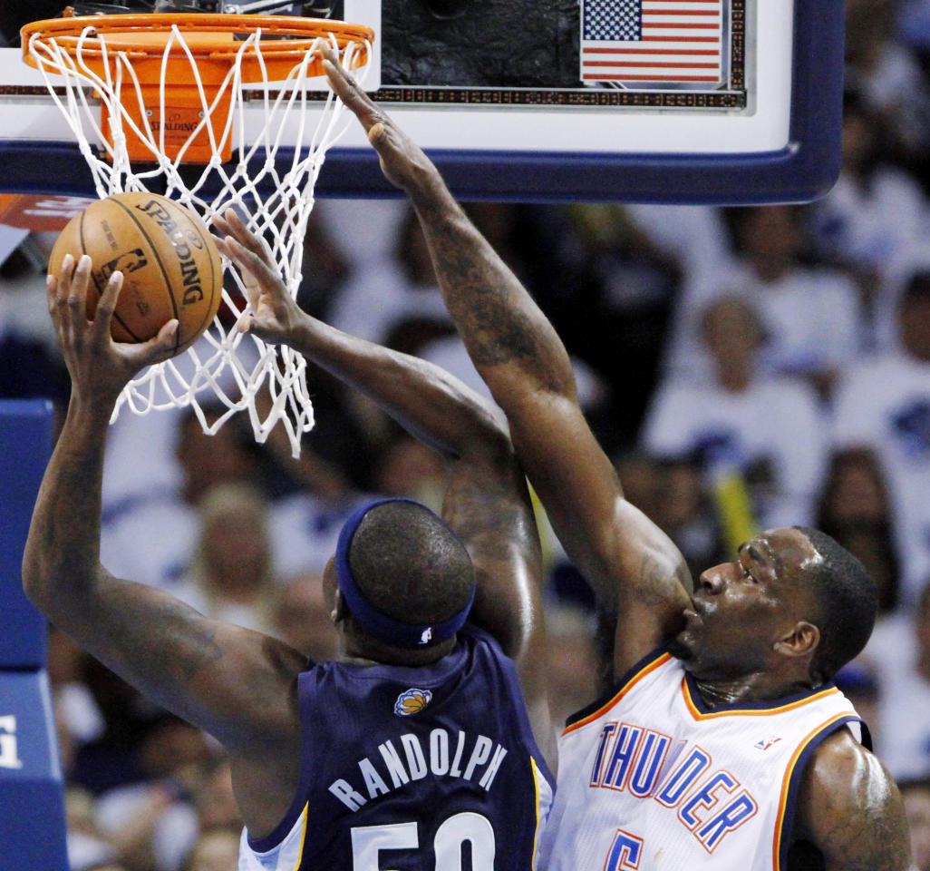 Oklahoma City Thunder center Kendrick Perkins, right, defends as Memphis Grizzlies Zach Randolph goes to the basket during the first half of Game 5 of an NBA basketball playoffs Western Conference semifinal, in Oklahoma City, Wednesday, May 15, 2013. (AP Photo/Alonzo Adams)