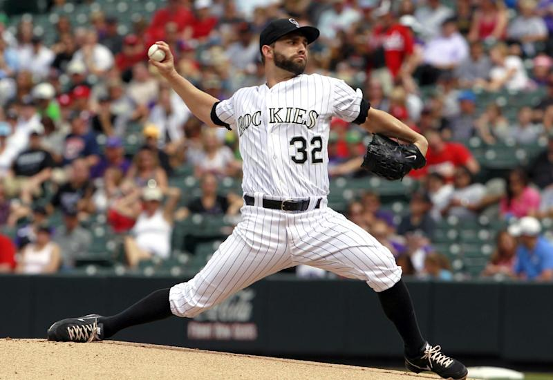 Helton reaches 2,500 hits as Rockies beat Reds 7-4