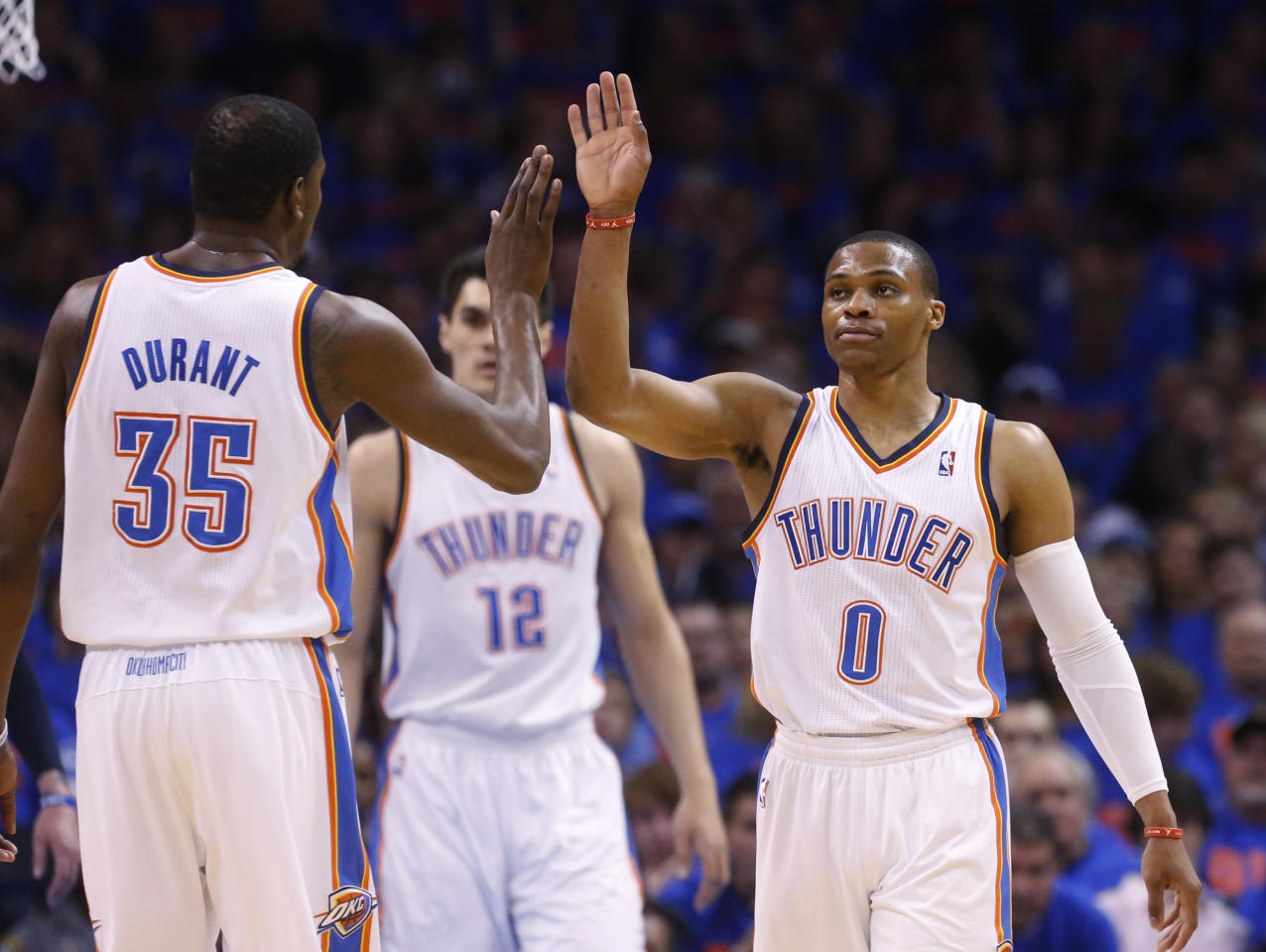 Oklahoma City Thunder guard Russell Westbrook (0) high fives teammate Kevin Durant (35) in the first quarter of Game 7 of an opening-round NBA basketball playoff series against the Memphis Grizzlies in Oklahoma City, Saturday, May 3, 2014. (AP Photo/Sue Ogrocki)
