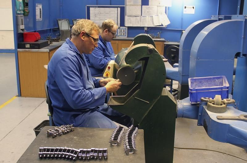 Employees of JJ Churchill precision engineering polish turbine blades in company's factory in Market Bosworth
