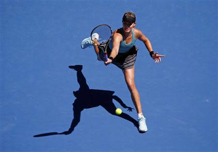 Eugenie Bouchard of Canada hits a return to Ana Ivanovic of Serbia during their women's quarter-final tennis match at the Australian Open 2014 tennis tournament in Melbourne