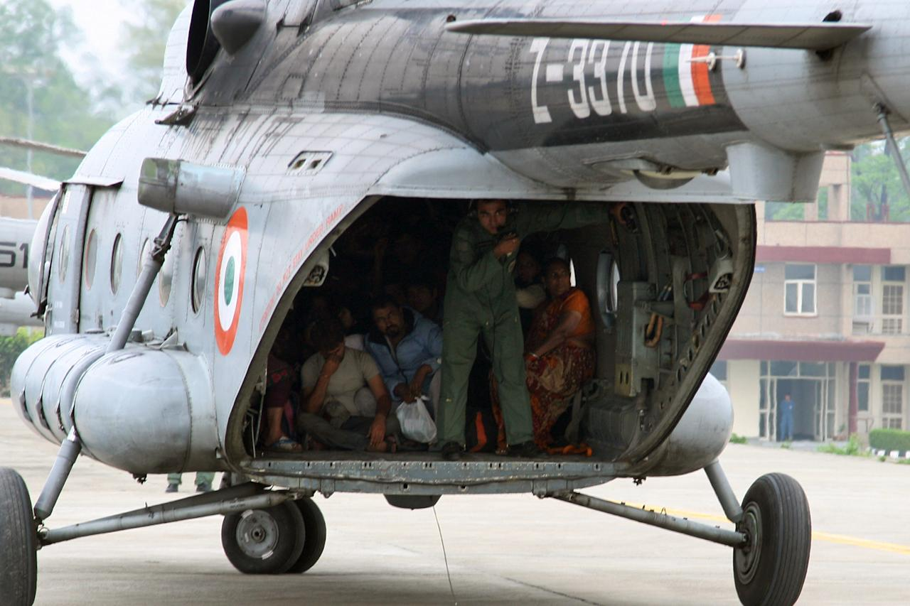 "In this photograph received from the Ministry of Defence on June 20, 2013, rescued flood evacuees are pictured inside the cargo bay of an Indian Air Force Mi-17 helicopter following flash floods in the northern Uttarakhand state. India's military battled on June 20 to reach villages and towns cut off by flash floods and landslides in the country's north as officials warned at least 1,000 people may have been killed. AFP PHOTO/INDIAN ARMY   ----EDITORS NOTE---- RESTRICTED TO EDITORIAL USE - MANDATORY CREDIT -  ""AFP PHOTO/INDIAN ARMY"" - NO MARKETING NO ADVERTISING CAMPAIGNS - DISTRIBUTED AS A SERVICE TO CLIENTS -----"