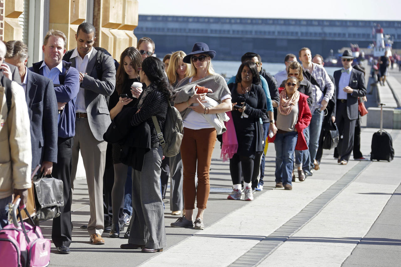 With the BART transit system on strike, people line up along the Embarcadero near the Ferry Building to catch a ferry to Oakland, Calif., during the afternoon commute Monday, Oct. 21, 2013, in San Francisco. Frustrated bay area commuters started the work week Monday facing gridlocked roadways and long lines for buses and ferries as a major transit strike entered its fourth day, increasing pressure on negotiators to reach a deal that resumes train service. (AP Photo/Eric Risberg)