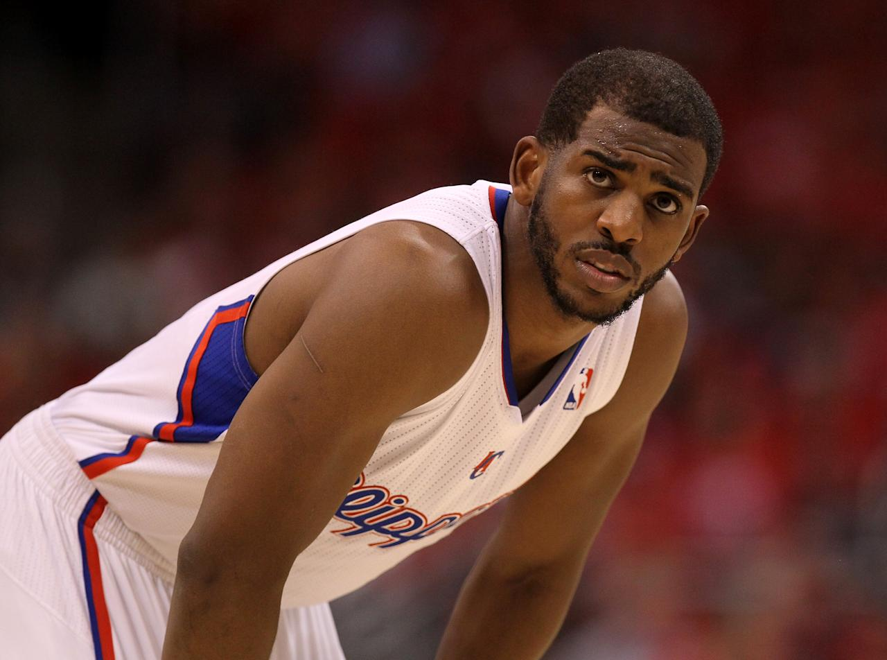 Chris Paul #3 of the Los Angeles Clippers waits for paly to begin during the game with the Memphis Grizzlies in Game Four of the Western Conference Quarterfinals in the 2012 NBA Playoffs on May 7, 2011 at Staples Center in Los Angeles, California. The Clippers won 101-97 in overtime to take a three games to one lead in the series.  The Grizzlies won 90-88 to tie the series at three games each.  NOTE TO USER: User expressly acknowledges and agrees that, by downloading and or using this photograph, User is consenting to the terms and conditions of the Getty Images License Agreement.  (Photo by Stephen Dunn/Getty Images)