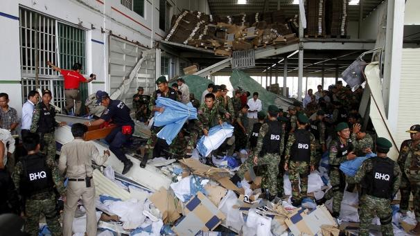 """At least two people were killed when part of a shoe factory collapsed in Cambodia. A concrete roof fell down at the plant in Kampong Speu province, west of the capital Pnomh Penh.  Reports suggest around 100 people could have been working in the factory at the time. It is not clear how many people have been killed – but the Cambodian government has confirmed two deaths.  Cambodian Social Affairs Minister Ith Samheng said: """"We pay our deep condolences to those who died. The government will organise an investigation into this incident and take measures to prevent something like this from happening again.""""  Samheng said no-one remained trapped in the building.  Workplace safety in the global garment industry has been in the spotlight in recent weeks – after a clothing factory collapsed in Bangladesh in April, killing more than 1,100 people."""