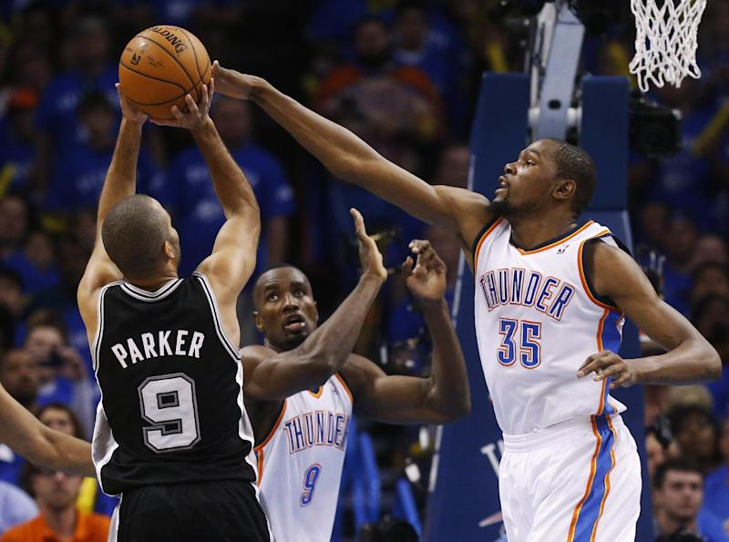 Oklahoma City Thunder forward Kevin Durant (35) blocks a shot by San Antonio Spurs guard Tony Parker (9), of France, in the second quarter of Game 3 of an NBA basketball playoff series in the Western Conference finals, Sunday, May 25, 2014, in Oklahoma City. Oklahoma City won 106-97