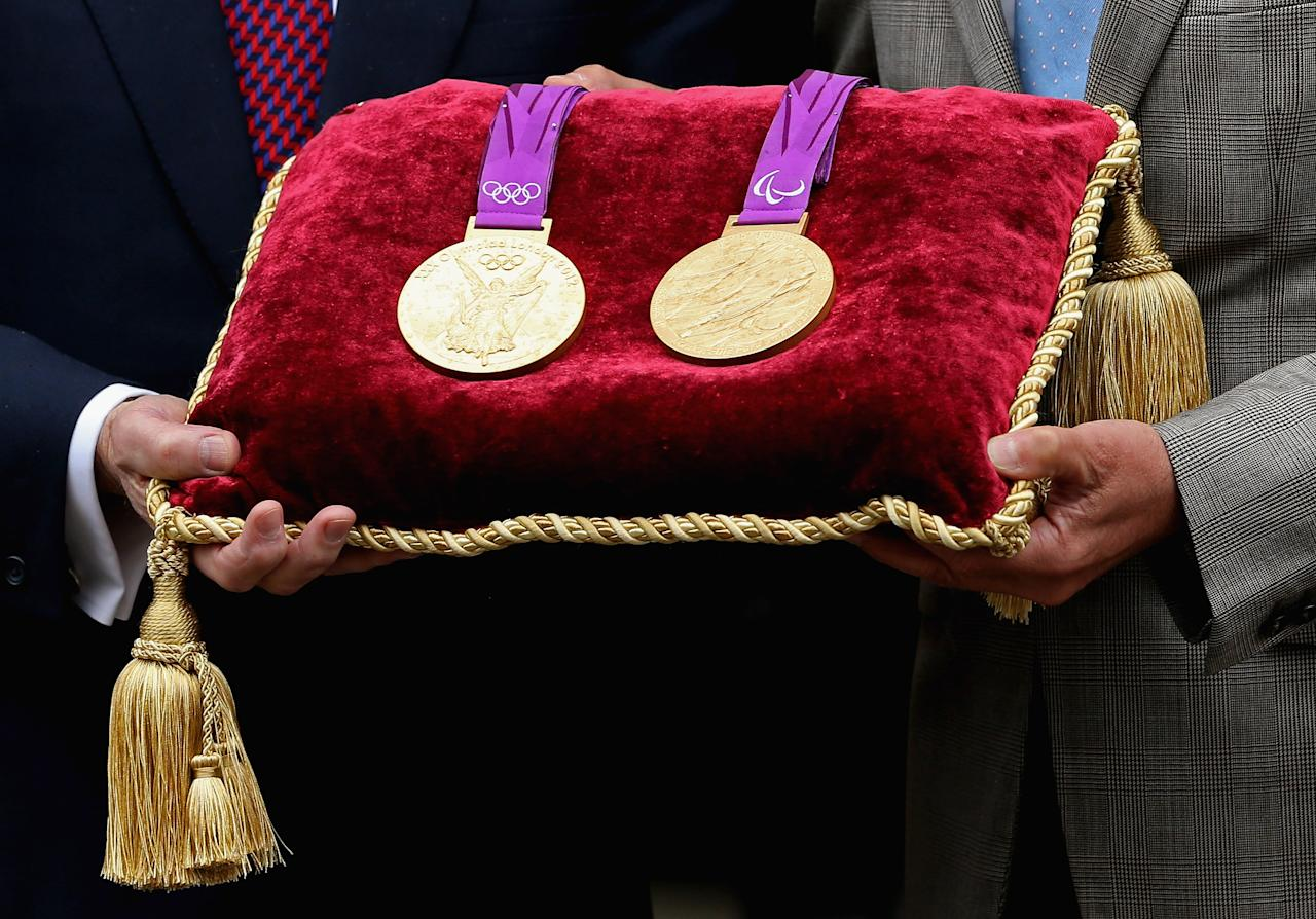 Around 4,700 medals have been produced for the Olympic and Paralympic Games by the Royal Mint. They were designed by David Watkins (Olympics) and Lin Cheung (Paralympics). Each medal weighs 375–400g, has a diameter of 85mm and is 7mm thick, with the sport and discipline engraved on the rim.