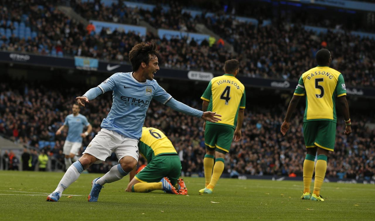 "Manchester City's David Silva (L) celebrates after scoring his side's second goal during their English Premier League soccer match against Norwich City at the Etihad Stadium in Manchester, northern England November 2, 2013. REUTERS/Phil Noble (BRITAIN - Tags: SPORT SOCCER) FOR EDITORIAL USE ONLY. NOT FOR SALE FOR MARKETING OR ADVERTISING CAMPAIGNS. NO USE WITH UNAUTHORIZED AUDIO, VIDEO, DATA, FIXTURE LISTS, CLUB/LEAGUE LOGOS OR ""LIVE"" SERVICES. ONLINE IN-MATCH USE LIMITED TO 45 IMAGES, NO VIDEO EMULATION. NO USE IN BETTING, GAMES OR SINGLE CLUB/LEAGUE/PLAYER PUBLICATIONS"