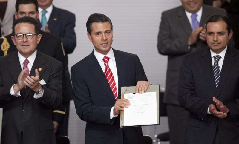 Mexico moves against TV, telephone tycoons