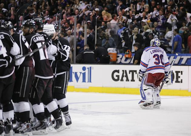 Members of the Los Angeles Kings celebrate Justin Williams's goal as New York Rangers goalie Henrik Lundqvist, of Sweden, skates off in overtime of Game 1 in the NHL Stanley Cup Final hockey series on Wednesday, June 4, 2014, in Los Angeles.(AP Photo/Jae C. Hong)