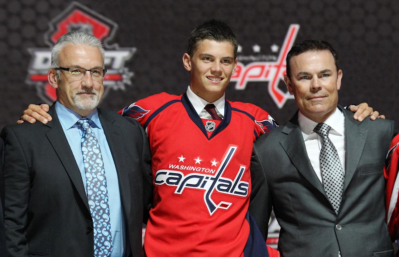 Jun 30, 2013; Newark, NJ, USA; Andre Burakovsky poses for a photo with team officials after being introduced as the number twenty-three overall pick to the Washington Capitals during the 2013 NHL Draft at the Prudential Center. (Ed Mulholland-USA TODAY Sports)