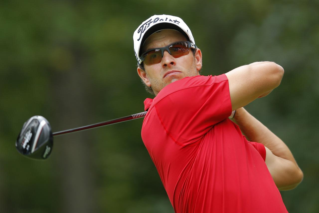 Adam Scott of Australia tees off on the first hole during the first round of the Deutsche Bank Championship golf tournament in Norton, Massachusetts August 30, 2013. REUTERS/Brian Snyder (UNITED STATES - Tags: SPORT GOLF)