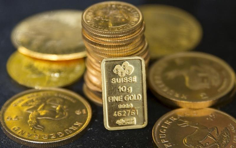 Gold slides to two-week low after US inflation data