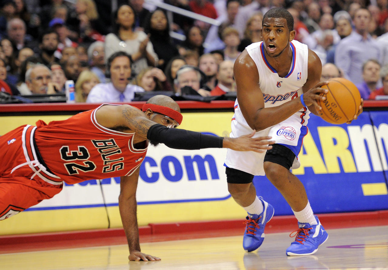 Los Angeles Clippers guard Chris Paul, right, drives toward the basket as Chicago Bulls guard Richard Hamilton (32) dives for a steal during the first half of their NBA basketball game, Friday, Dec. 30, 2011, in Los Angeles. (AP Photo/Mark J. Terrill)