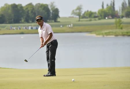 Thongchai of Thailand hits a putt on the 18th hole during the final round of the Nordea Masters golf tournament at PGA National in Malmo