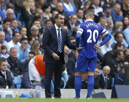 Everton's manager Martinez talks with Barkley during their English Premier League soccer match against Manchester City in Manchester