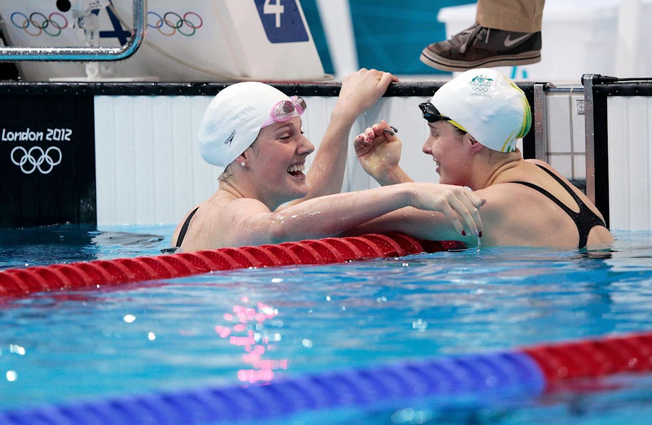 LONDON, ENGLAND - JULY 29: (L-R) Missy Franklin of the United States and Belinda Hocking of Australia hug after competing in the Women's 100m Backstroke heat 6 on Day 2 of the London 2012 Olympic Games at the Aquatics Centre on July 29, 2012 in London, England.  (Photo by Adam Pretty/Getty Images)