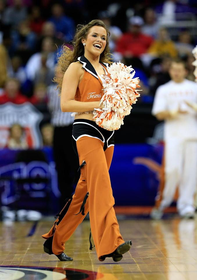 KANSAS CITY, MO - MARCH 13:  Texas Longhorns cheerleaders perform during the first round of the 2013 Big 12 Men's Basketball Championship at Sprint Center on March 13, 2013 in Kansas City, Missouri.  (Photo by Jamie Squire/Getty Images)