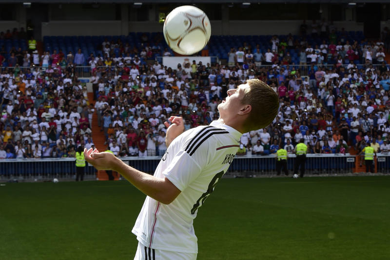 Real Madrid's German midifielder Toni Kroos controls the ball during his presentation at the Santiago Bernabeu stadium in Madrid July 17, 2014