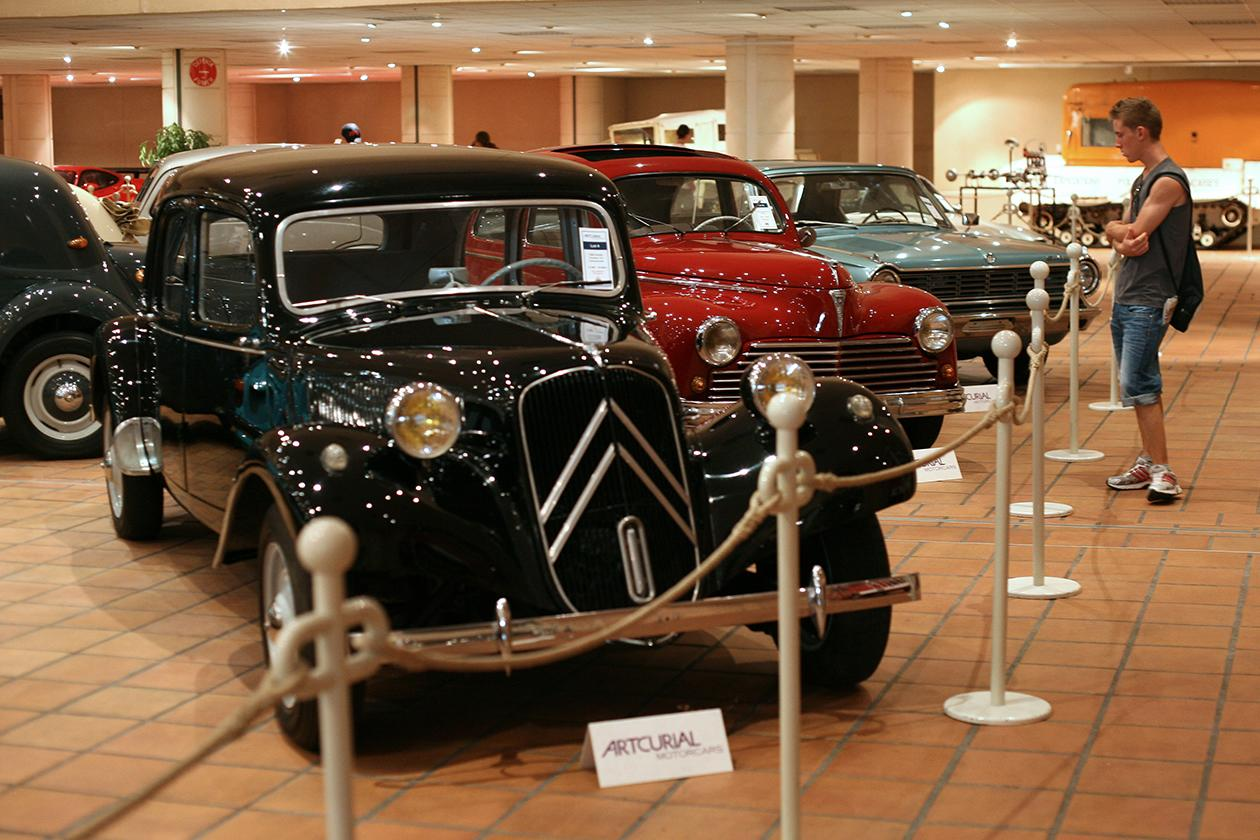 A visitor looks at the cars of the collection of Prince Albert II of Monaco at the Automobile Museum.