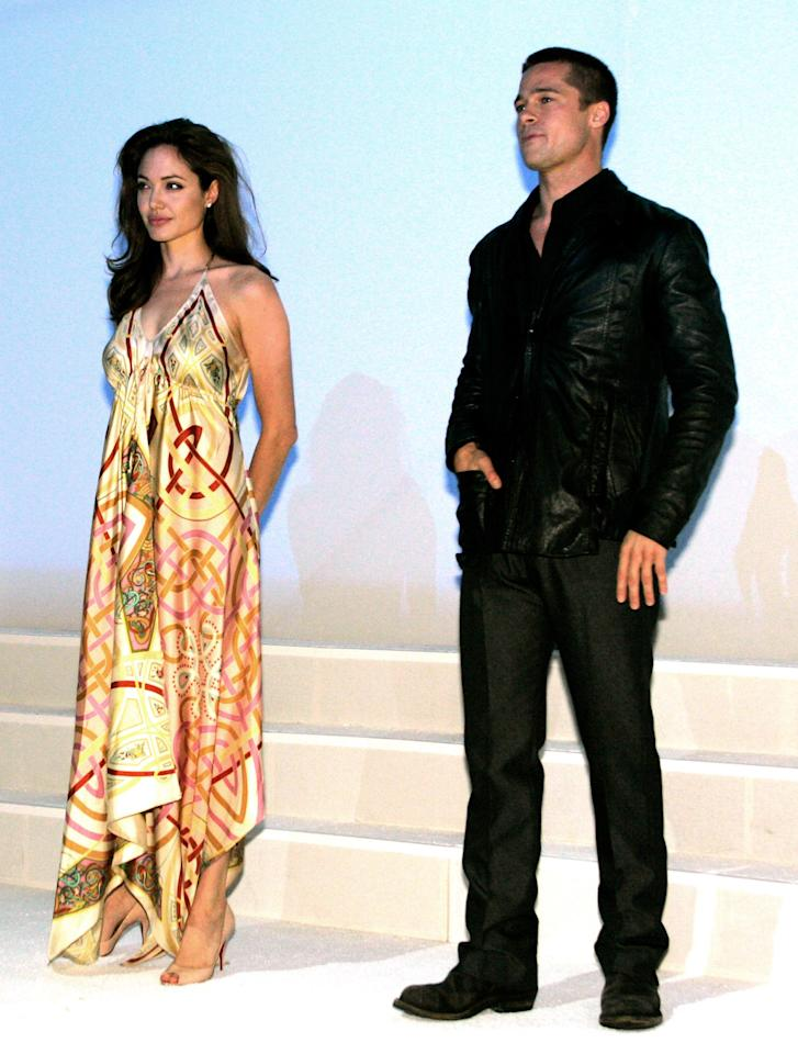 """File photo of actress Angelina Jolie and actor Brad Pitt onstage at the 20th Century Fox ShoWest presentation in Las Vegas, Nevada March 17, 2005. Jolie poured cold water on the rumors of a romance with leading man Brad Pitt, telling Marie Claire magazine in an upcoming issue that the two are not intimate. For months, speculation has swirled around the world that Pitt, 41, and Jolie, 30, were having a romantic affair since filming """"Mr. & Mrs. Smith"""" last year. Picture taken March 17, 2005. REUTERS/Ethan Miller/FILE   EM/GN"""