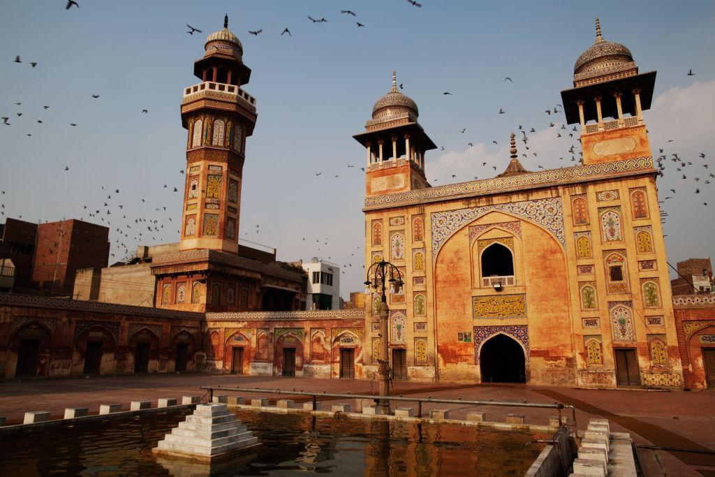 <p>LAHORE, PAKISTAN: Pigeons fly over the Wazir Khan Mosque in the walled city of Old Lahore in Pakistan. The great mosque was built by built by Hakim Shaikh Ilm-ud-din Ansari, court physician to the Mughal emperor Shah Jahan who later rose to the status of governor. Construction began around 1634–1635 and lasted seven years.</p>