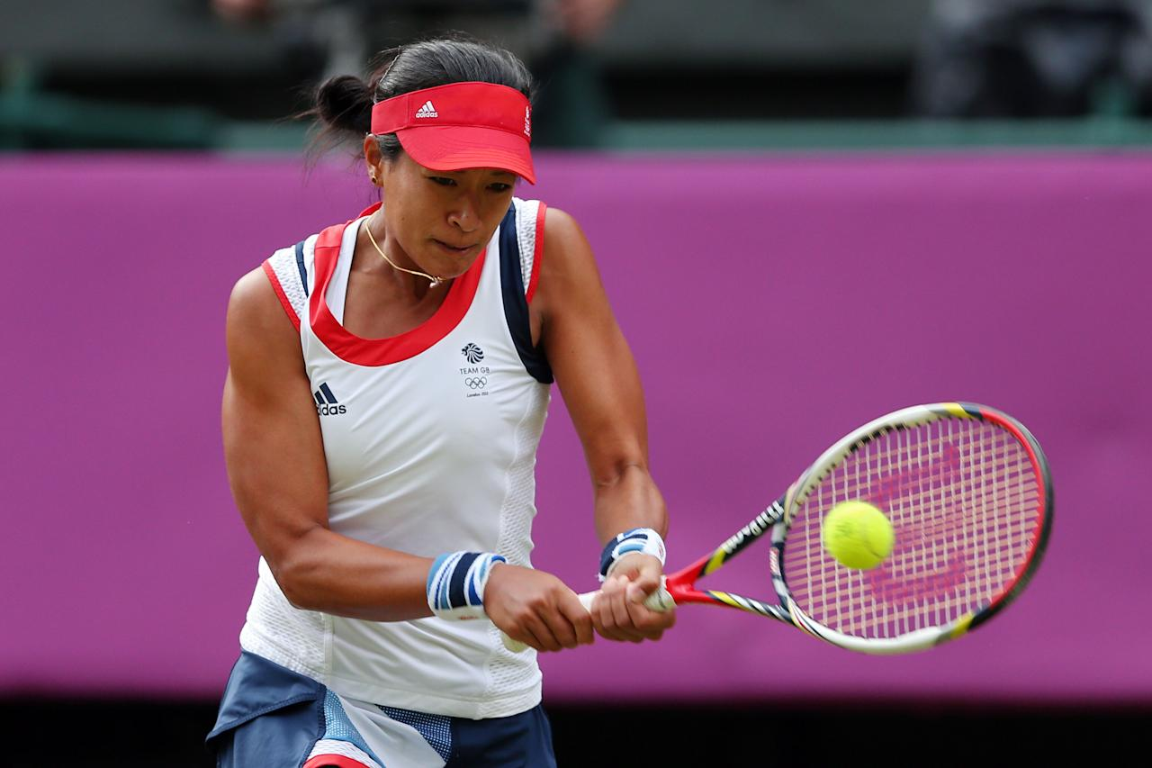 LONDON, ENGLAND - JULY 28:  Anne Keothavong of Great Britain returns a shot against Caroline Wozniacki of Denmark during their Women's Singles Tennis match on Day 1 of the London 2012 Olympic Games at the All England Lawn Tennis and Croquet Club in Wimbledon on July 28, 2012 in London, England.  (Photo by Clive Brunskill/Getty Images)