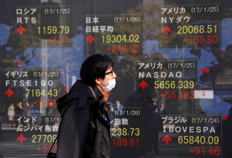 Asian shares mixed as Trump talks down US dollar
