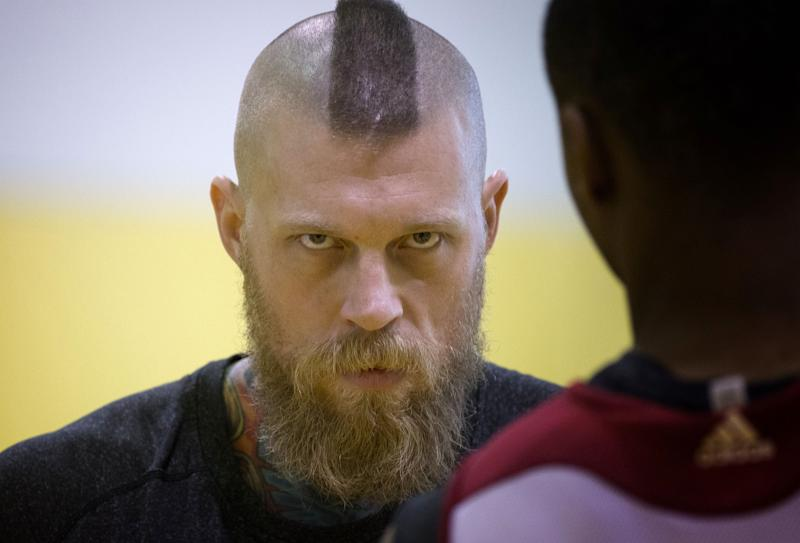 Miami Heat's Chris Andersen talks to coach Juwan Howard after a practice session in Miami, Thursday, May 22, 2014, as they prepare for  game three in their playoff series against the Indiana Pacers