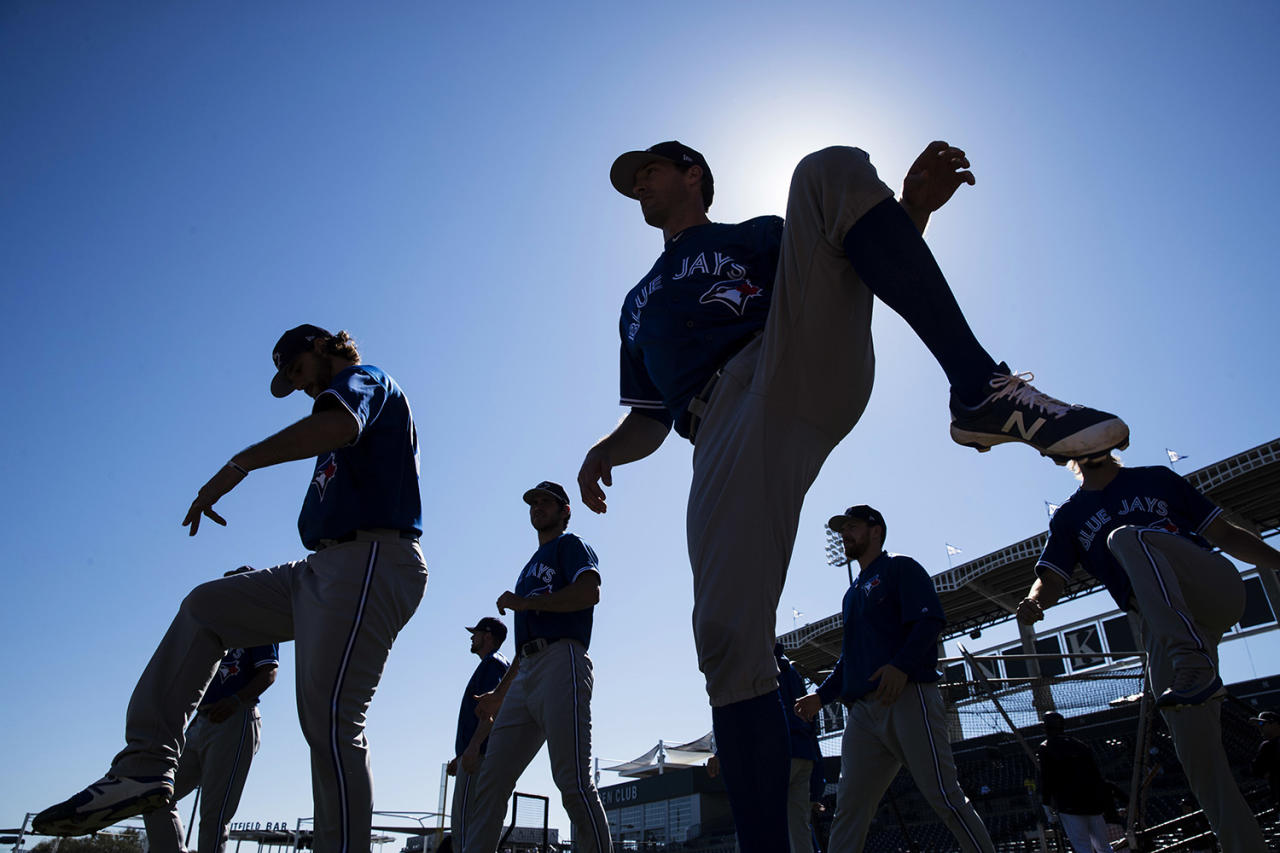 <p>Members of the Toronto Blue Jays warm up ahead of a spring training baseball game against the New York Yankees on Sunday, Feb. 26, 2017, in Tampa, Fla. (Photo: Matt Rourke/AP) </p>